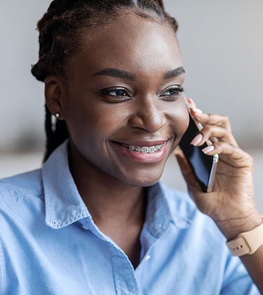 Smiling Woman With Braces | Orthodontic Braces Dentist Kalamazoo, MI | Karen Mitchell Dentistry